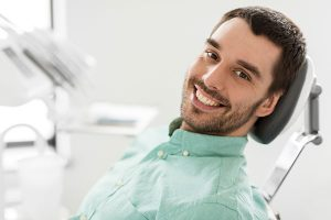 happy-smiling-patient-on-dental-chair