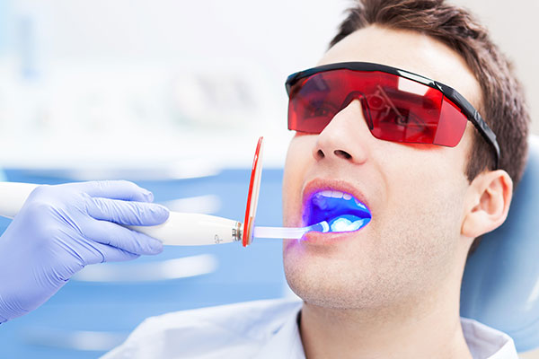 man-receiving-laser-dentistry