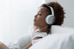 woman-relaxing-and-listening-to-music