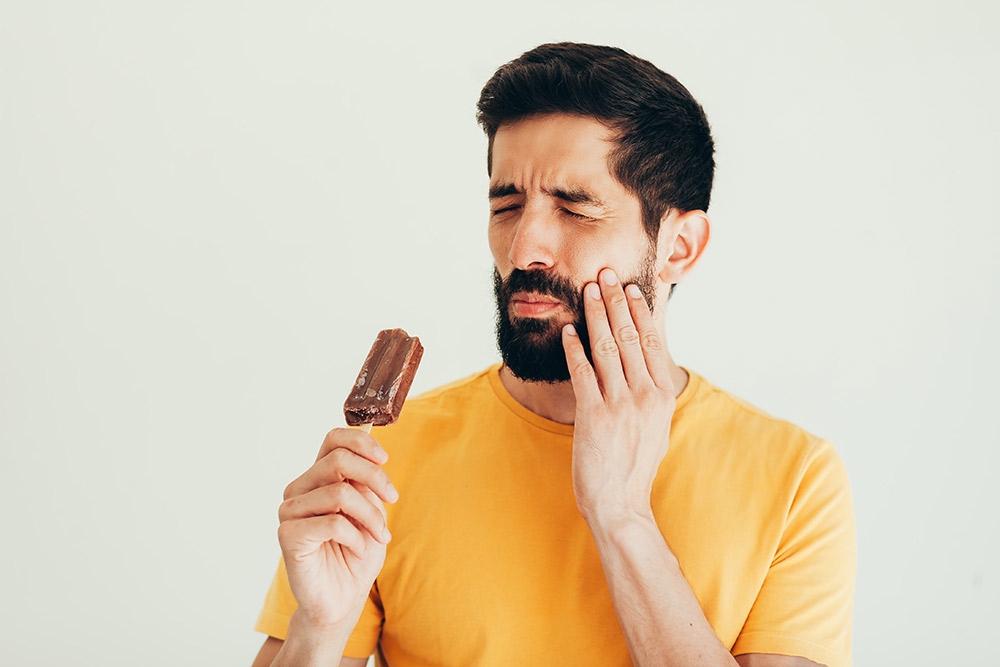 What Causes Tooth Sensitivity and How Can I Treat It?
